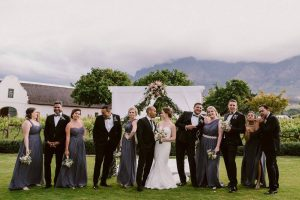 Wedding Party with Protea Arch | Image: Lad & Lass Photography