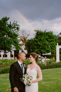 Bride and Groom with Rainbow | Image: Lad & Lass Photography