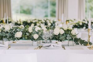 Low Floral and Greenery Centerpiece | Credit: Jani B & Bright and Beautiful