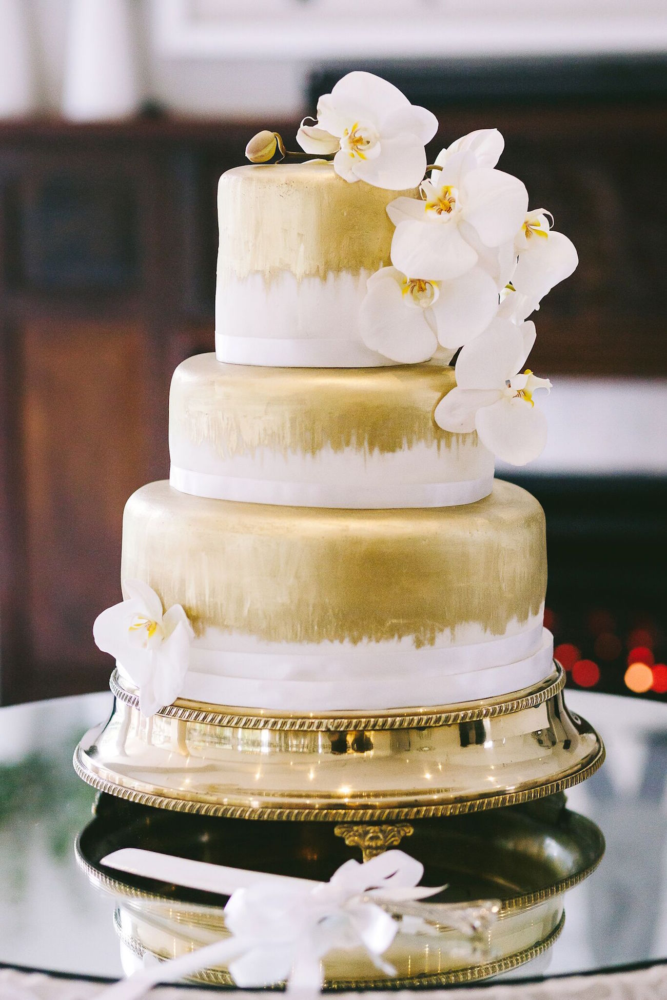 Gold Tiered Wedding Cake | Credit: Jani B & Bright and Beautiful