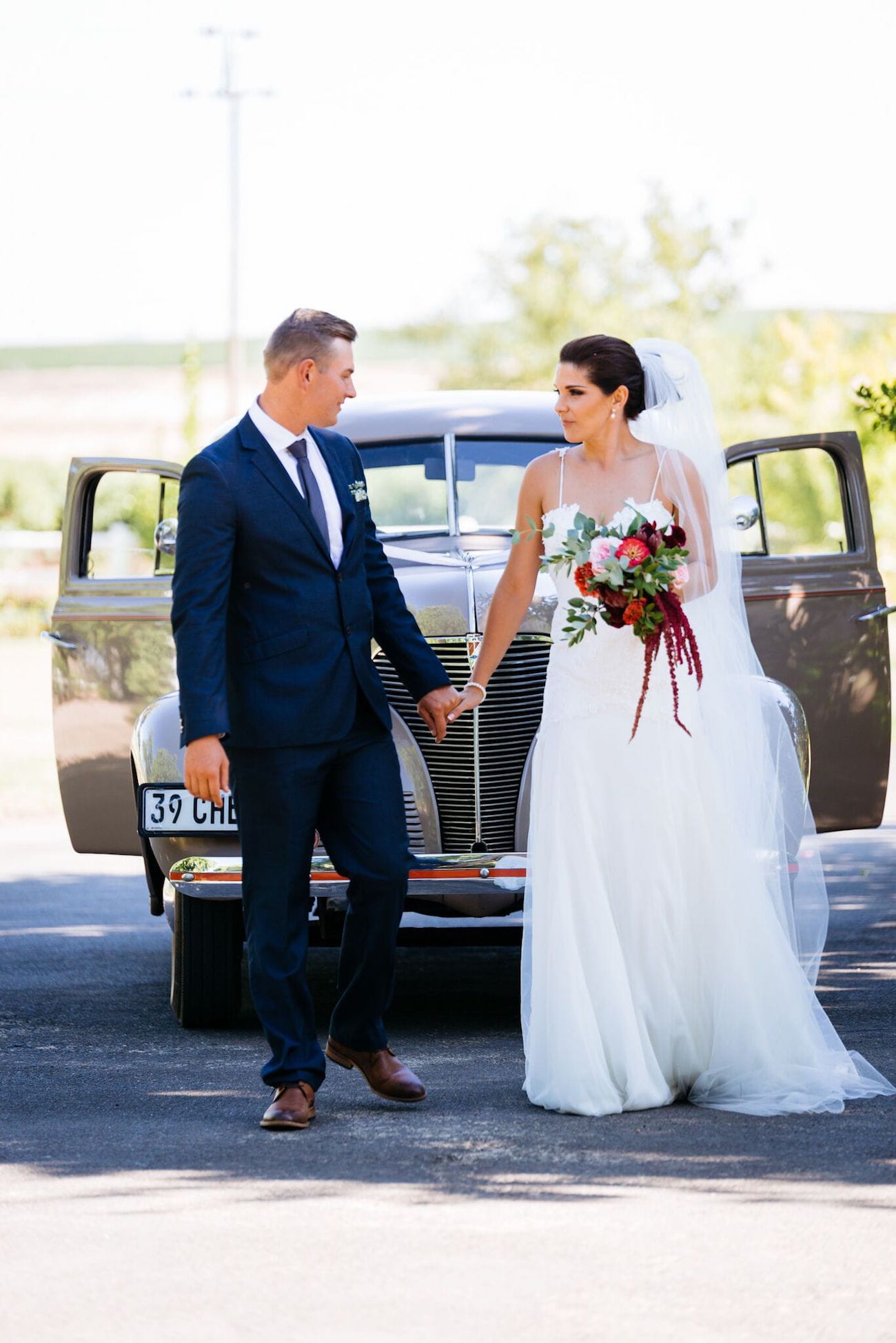 Bride & Groom with Vintage Car | Credit: Matthew Carr