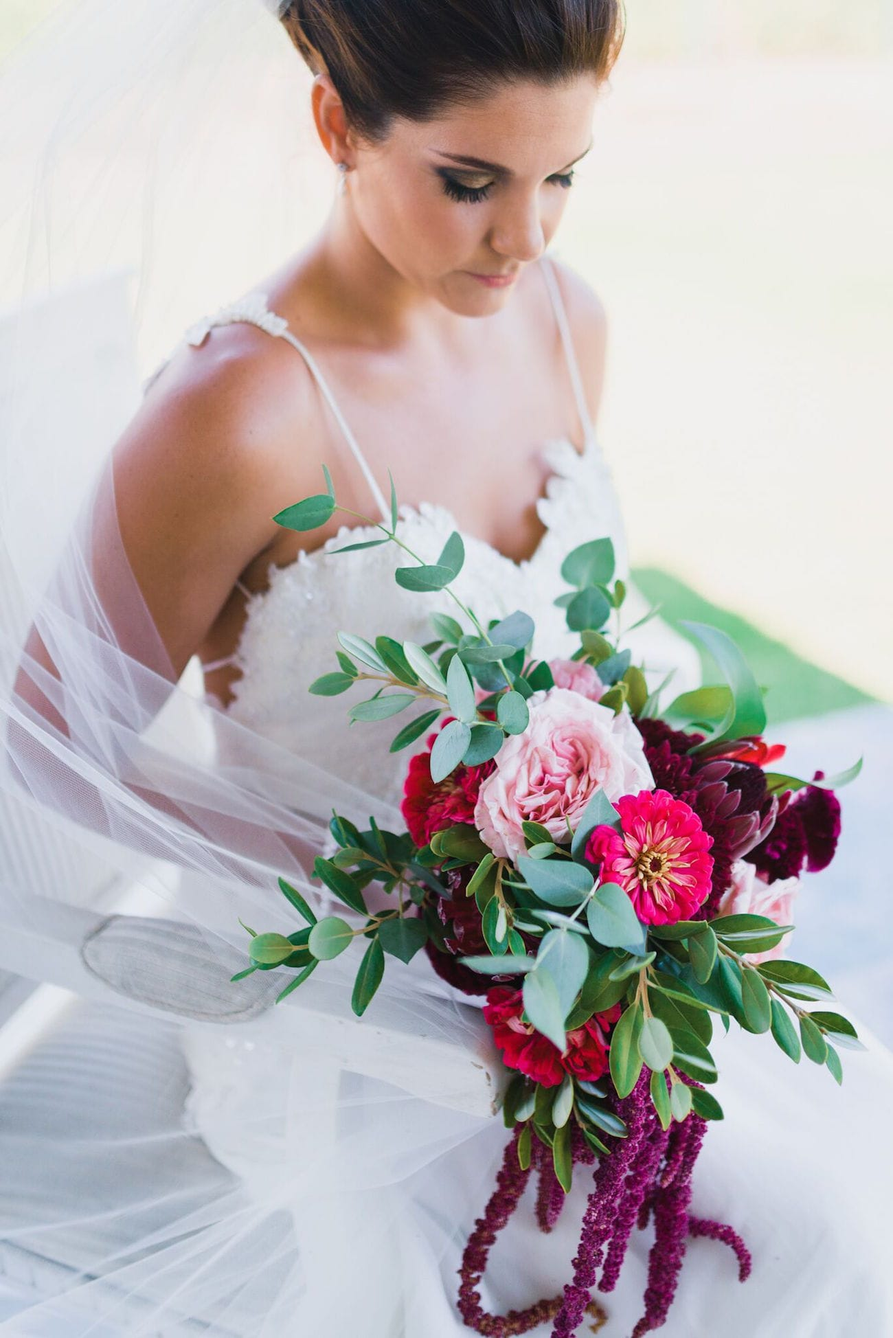 Jewel-tone bouquet with proteas, peonies and amaranthus | Credit: Matthew Carr