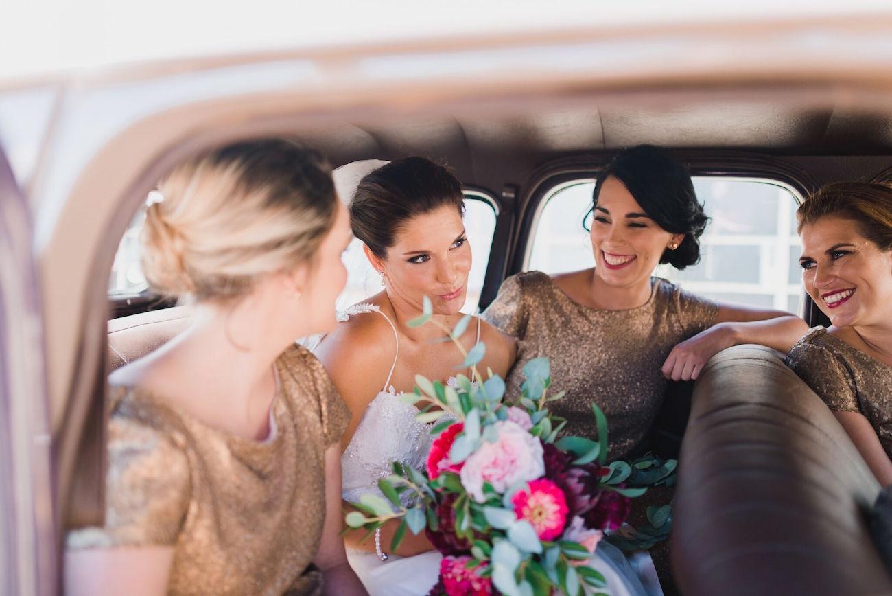 Bride and bridesmaids in vintage car | Credit: Matthew Carr