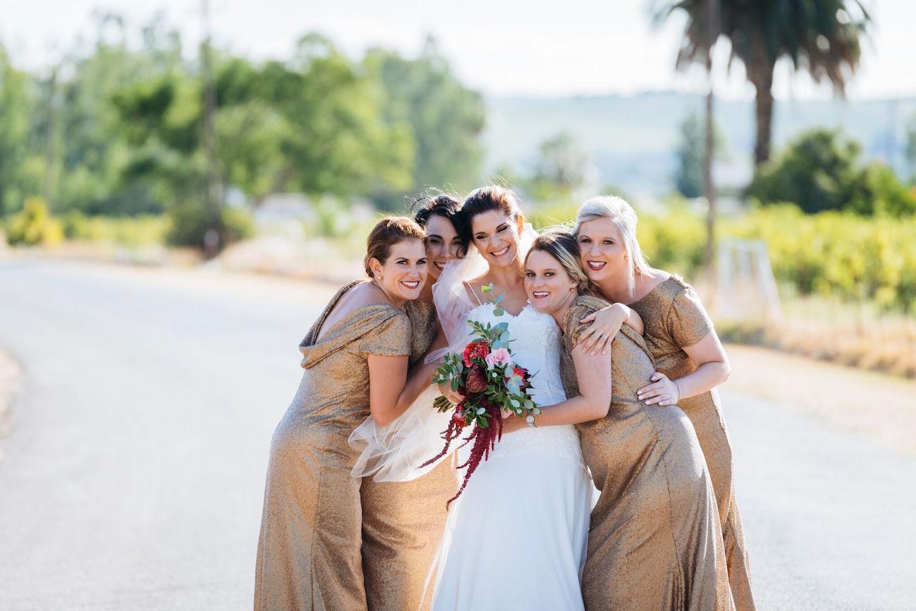 Long gold cowl back bridesmaid dresses | Credit: Matthew Carr