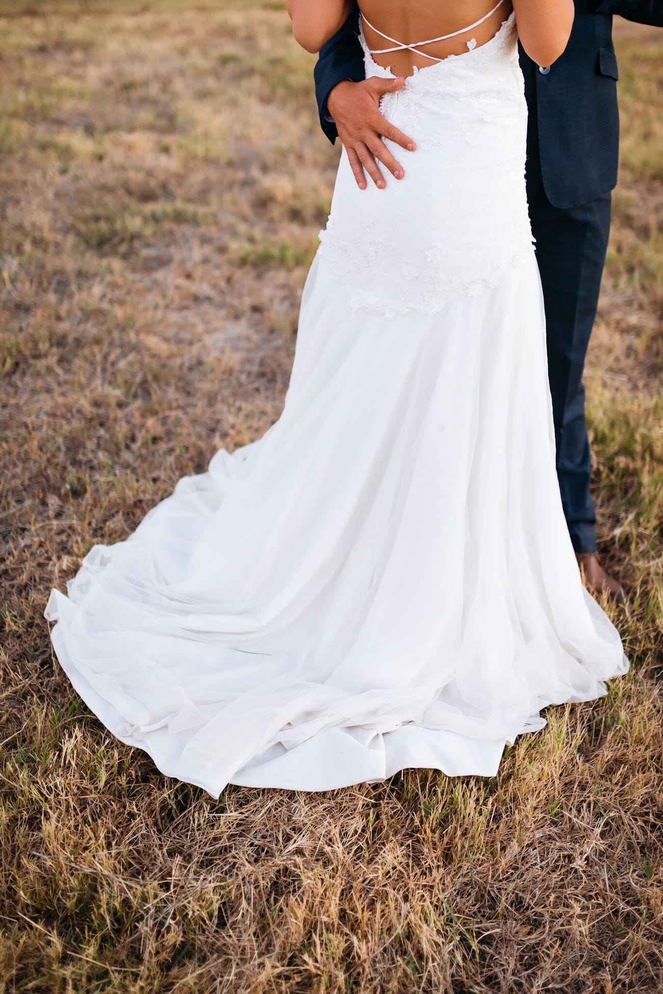 Delicate low back wedding dress with train | Credit: Matthew Carr