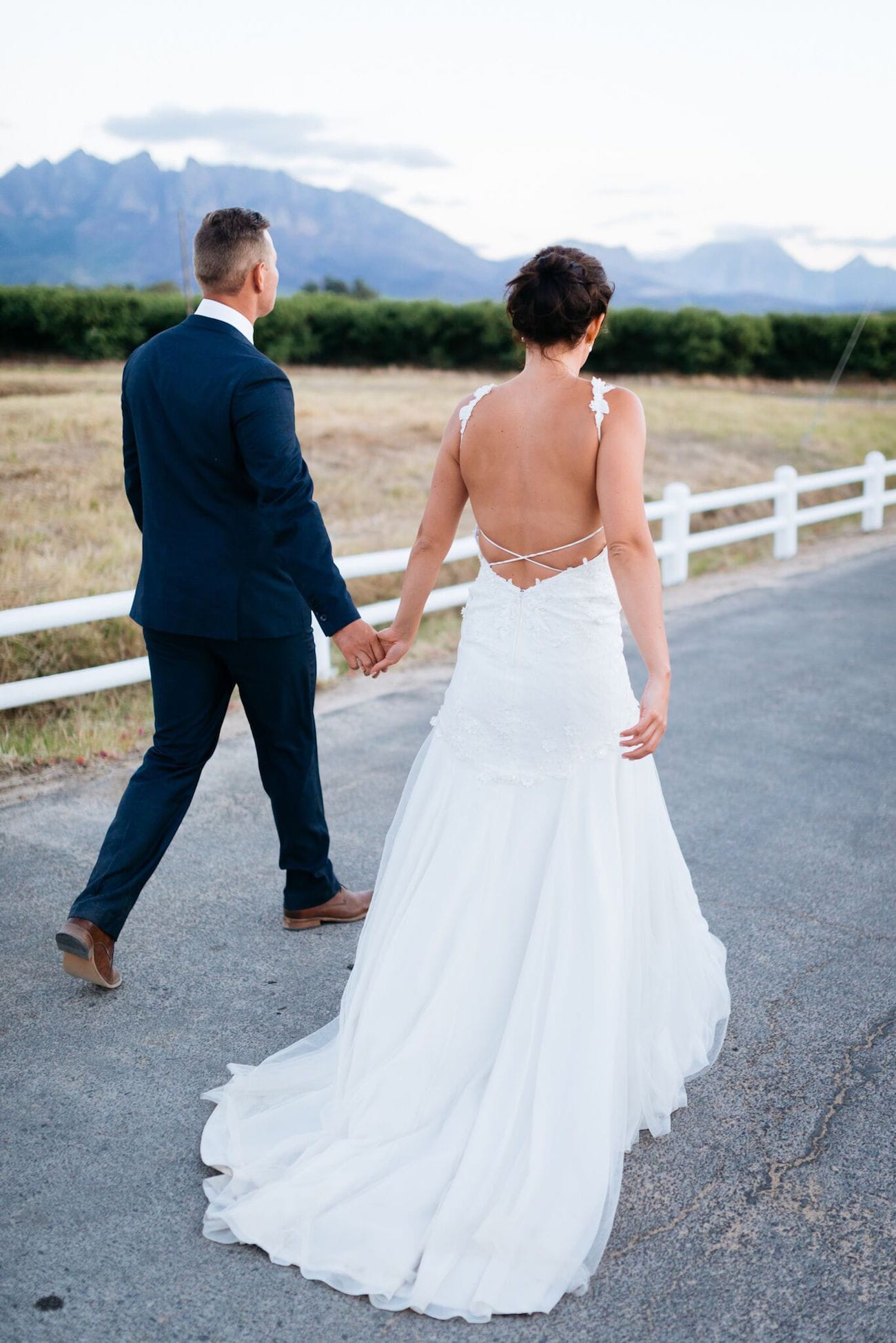 Bride in strappy low back wedding dress with criss-cross detail | Credit: Matthew Carr