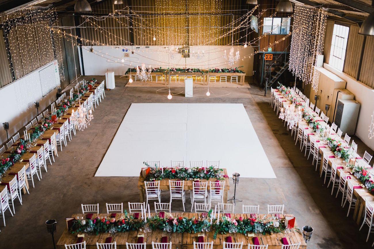 Barn wedding decor with central dance floor | Credit: Matthew Carr