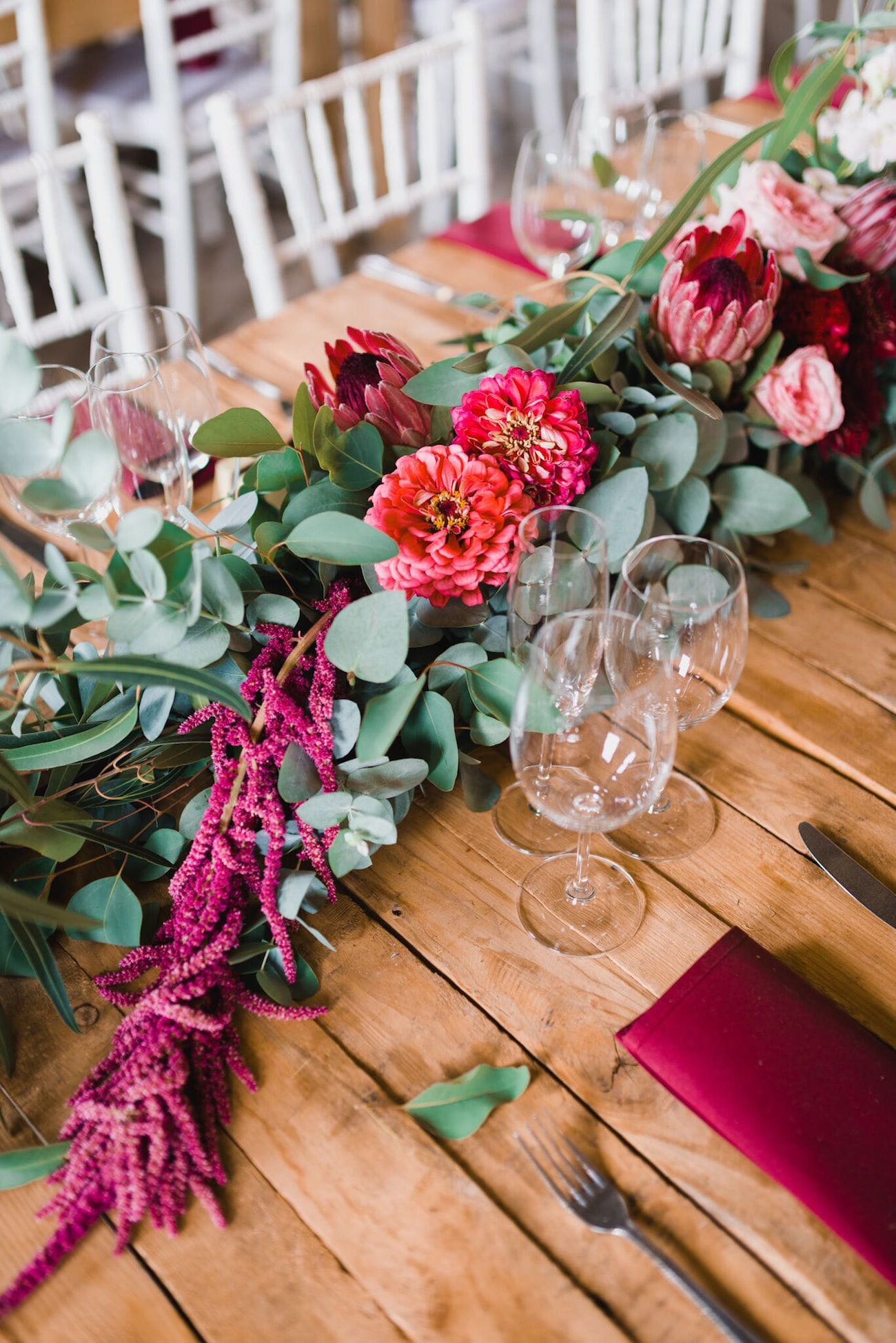 Greenery, protea and amaranthus floral runner | Credit: Matthew Carr