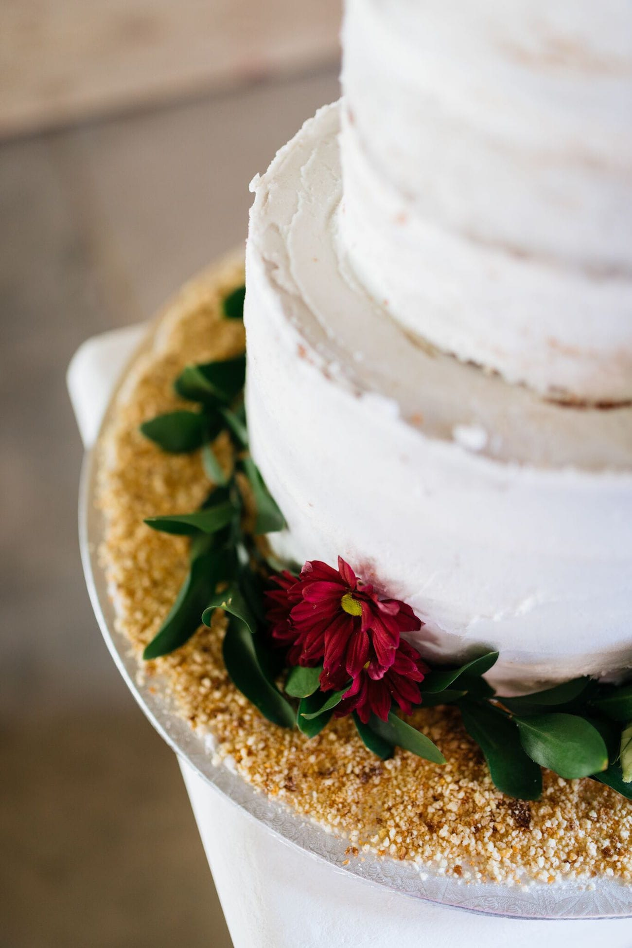 Cake decorated with glitter and greenery | Credit: Matthew Carr