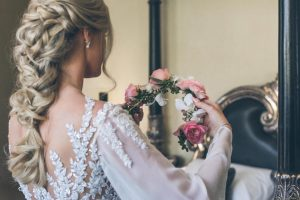 Bride with floral crown | Credit: Shanna Jones