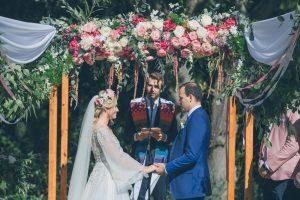 Vineyard Wedding Ceremony with Floral Arch | Credit: Shanna Jones