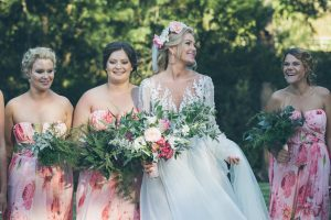 Bridesmaids in floral print | Credit: Shanna Jones