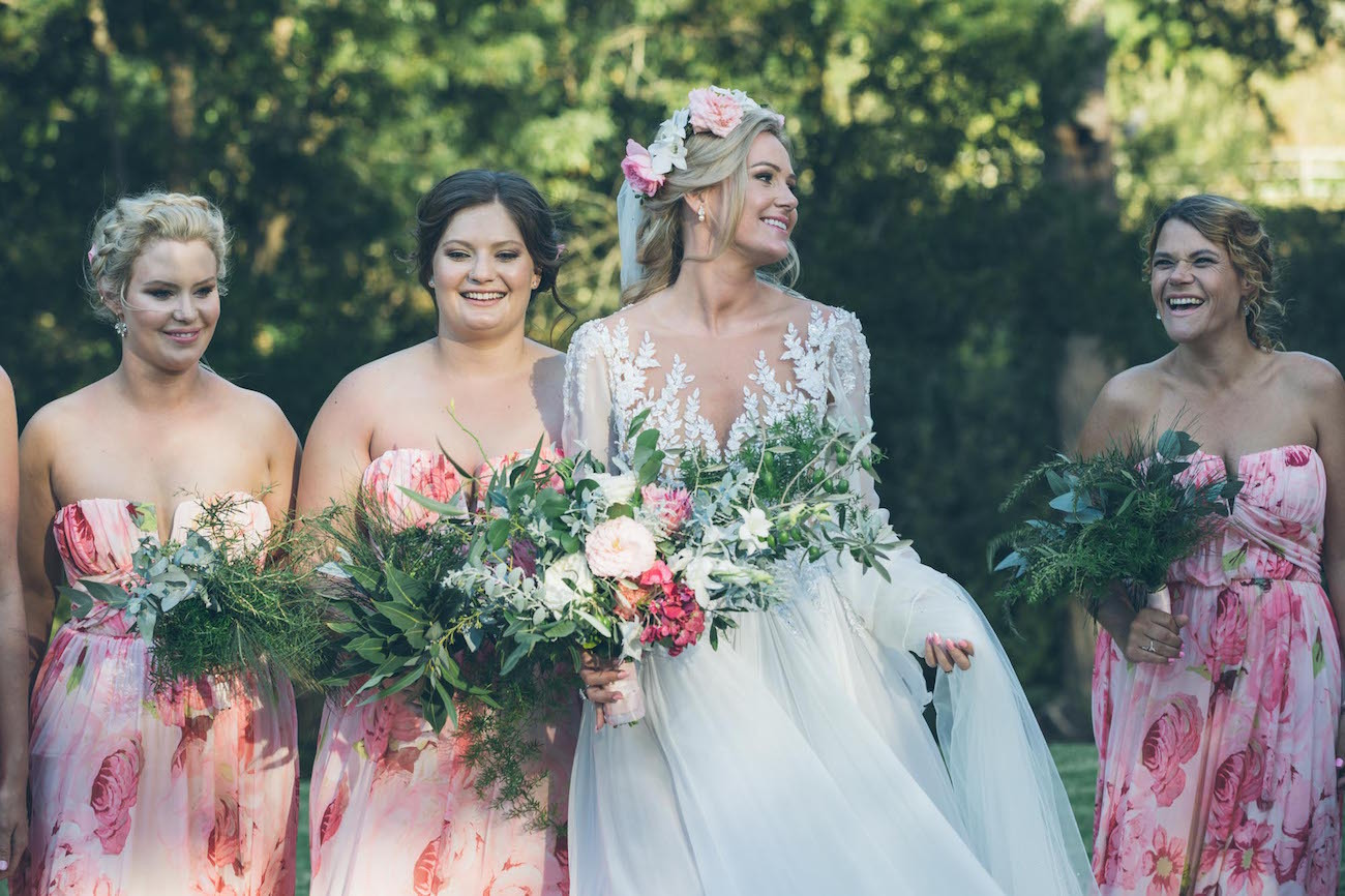 Bridesmaids in floral print | Credit: Shanna Jones