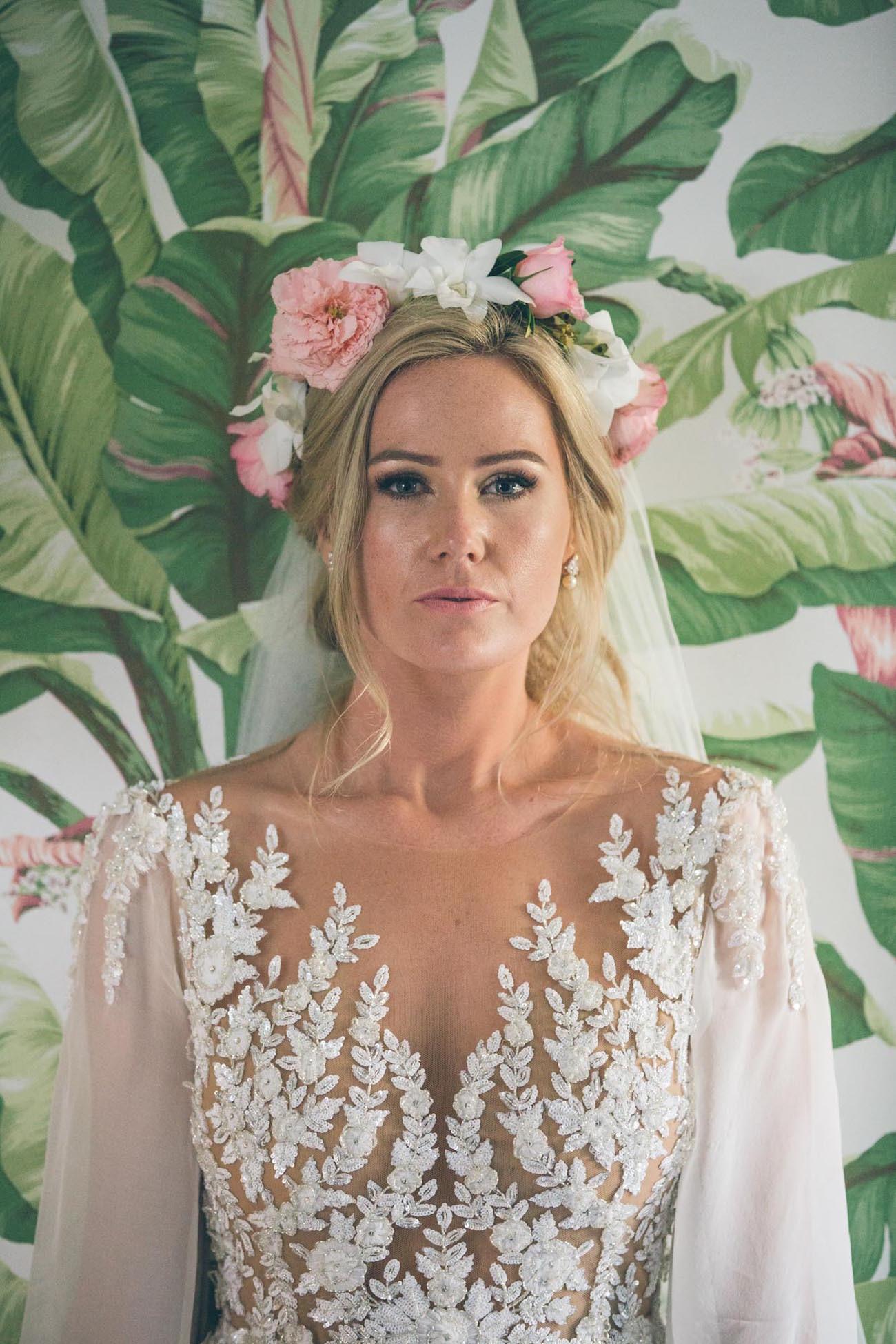 Bride in pink floral crown | Credit: Shanna Jones
