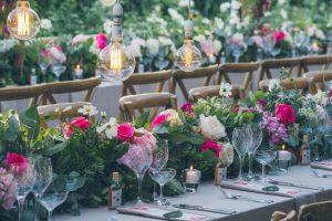 Lush floral wedding tables | Credit: Shanna Jones