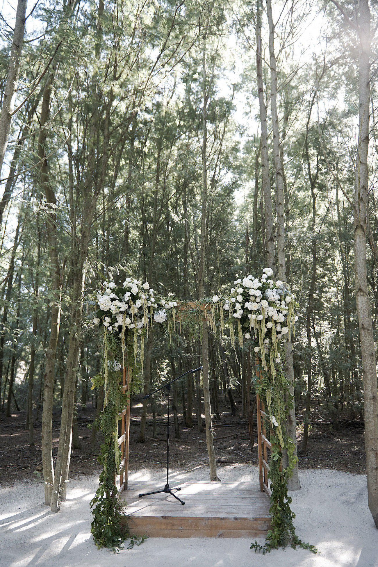 Wooden Floral Ceremony Arch | Image: Knit Together Photography