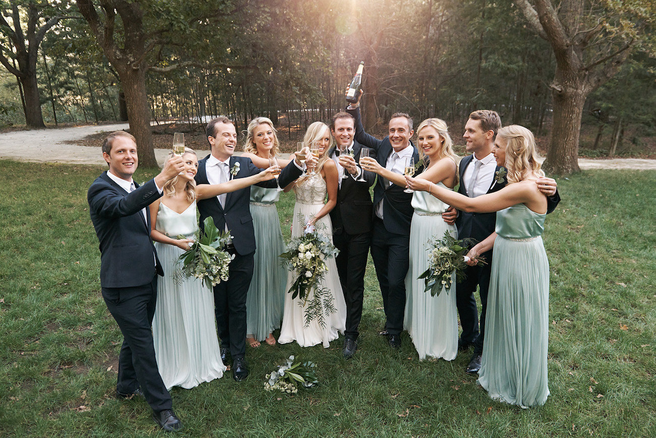 Wedding Party Celebrating with Champagne | Image: Knit Together Photography