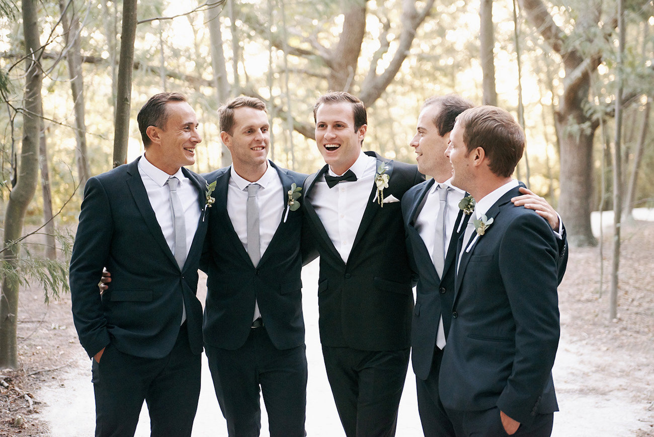 Groomsmen in Black Suits | Image: Knit Together Photography