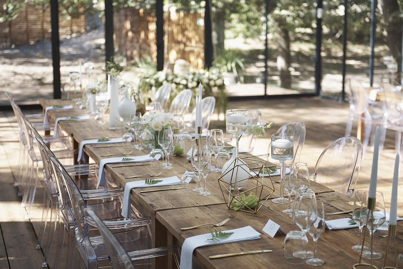 Raw Wood Table Wedding Decor with Ghost Chairs   Image: Knit Together Photography