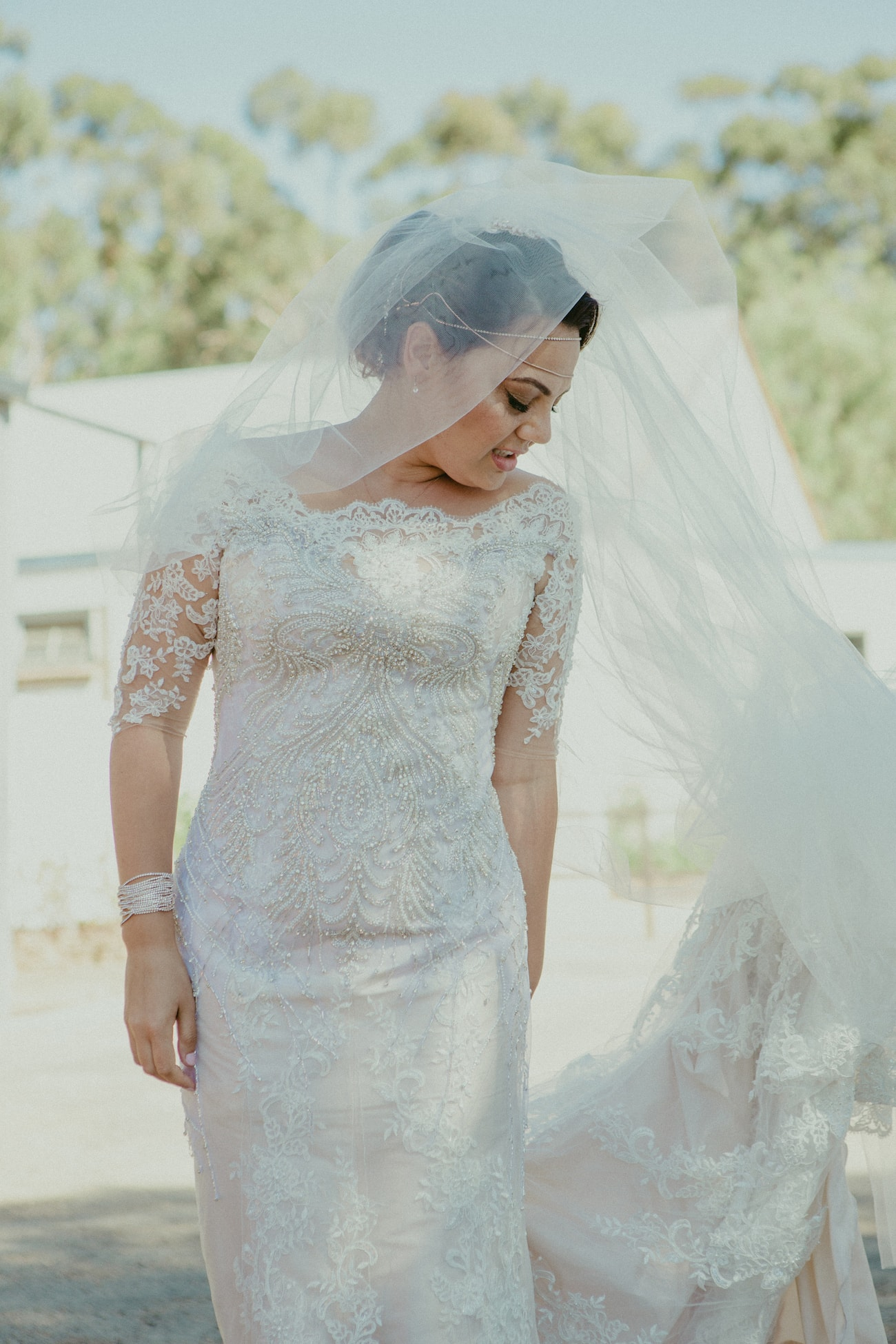 Beaded Lace Wedding Dress | Credit: Vivid Blue