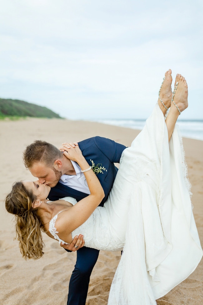 Dreamy Beach Wedding Kiss | Credit: Grace Studios / Absolute Perfection
