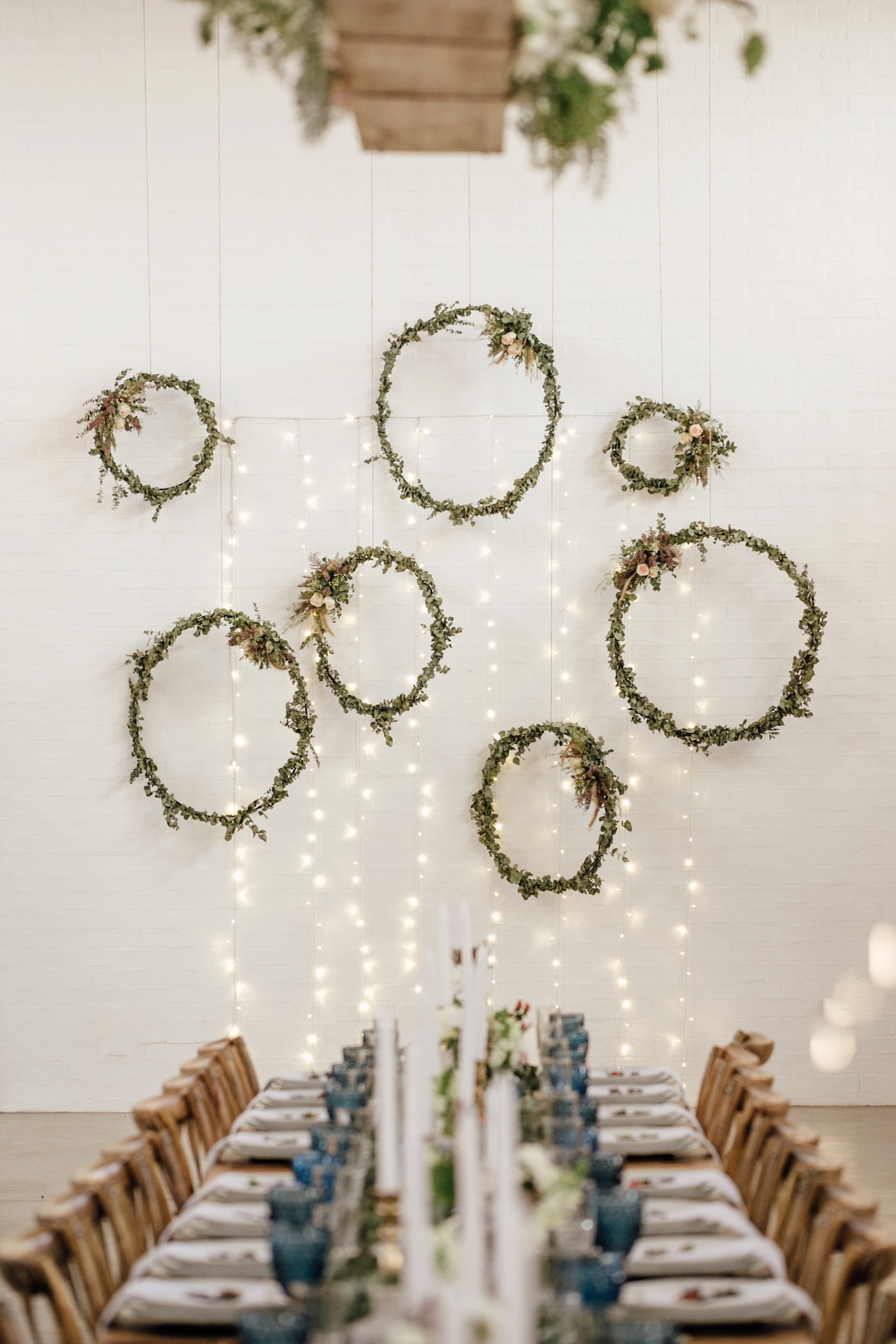 Hanging Greenery Wreaths | Credit: Page & Holmes