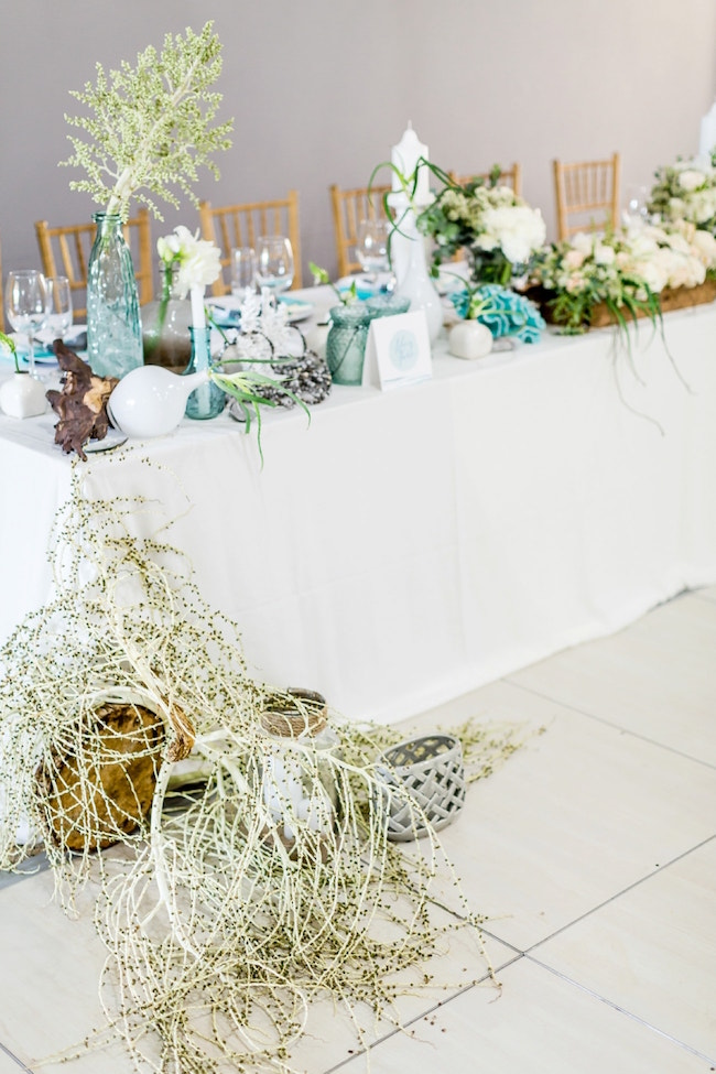 Dreamy Beach Wedding Decor with Grasses and Baskets | Credit: Grace Studios / Absolute Perfection