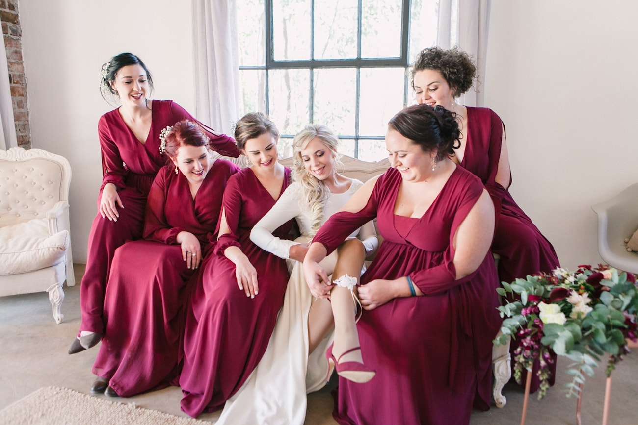 Maroon Bridesmaid Dresses | Joyous Jewel Tone Winter Wedding | Credit: Dust and Dreams Photography
