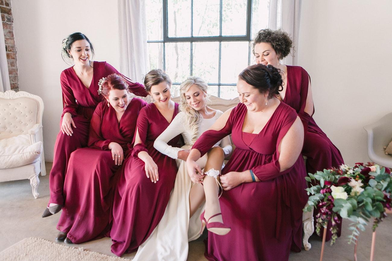 Maroon Bridesmaid Dresses | Joyous Jewel Tone Winter Wedding | Credit: Dust and Dreams Photography