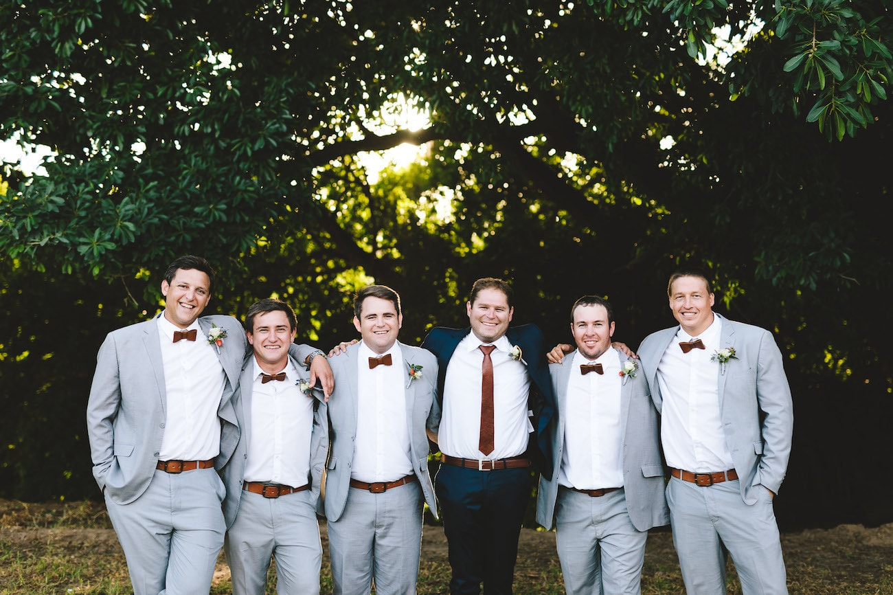 Groomsmen in Leather Bow Ties | Credit: Charlie Ray Photography