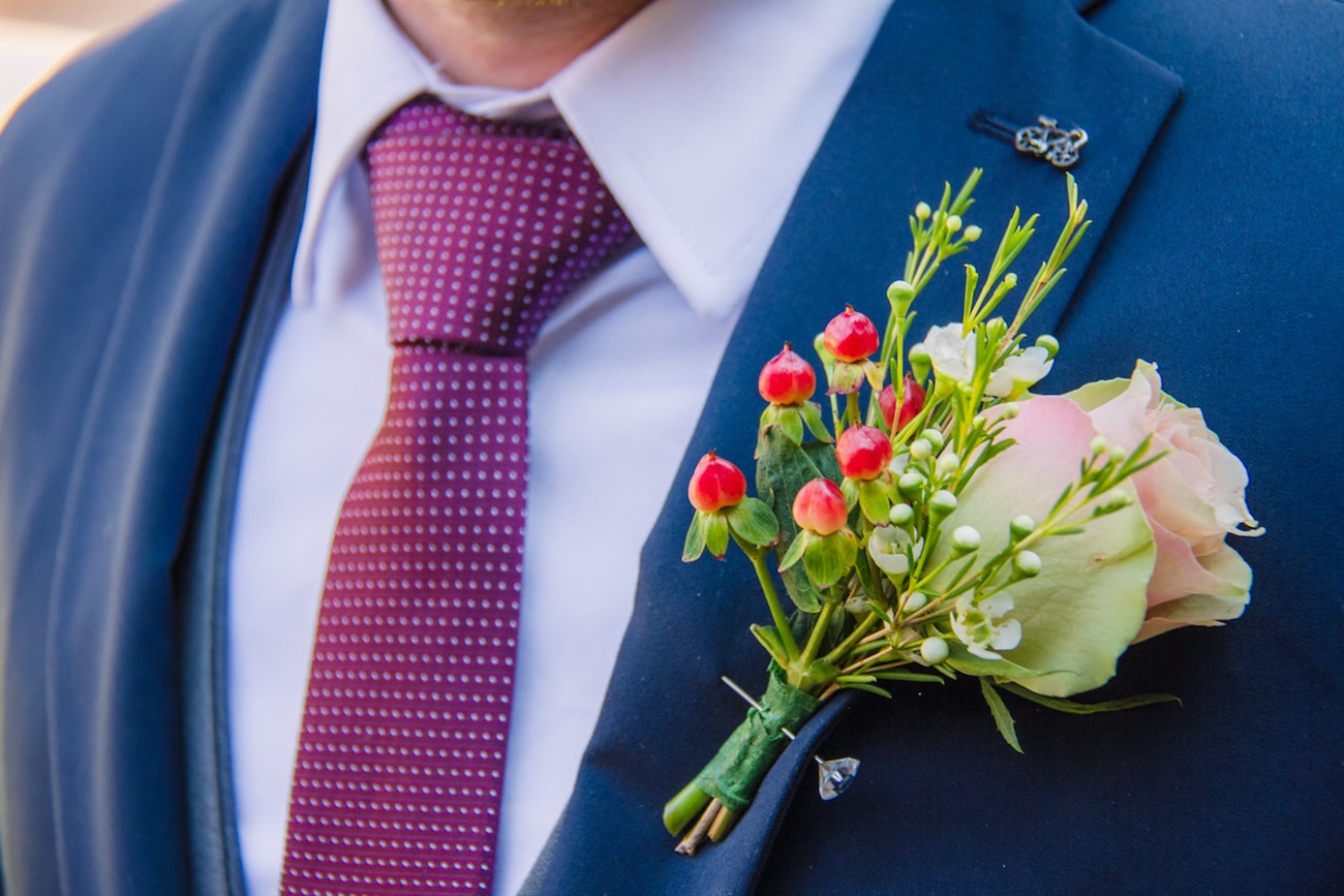 Berry Boutonniere | Joyous Jewel Tone Winter Wedding | Credit: Dust and Dreams Photography