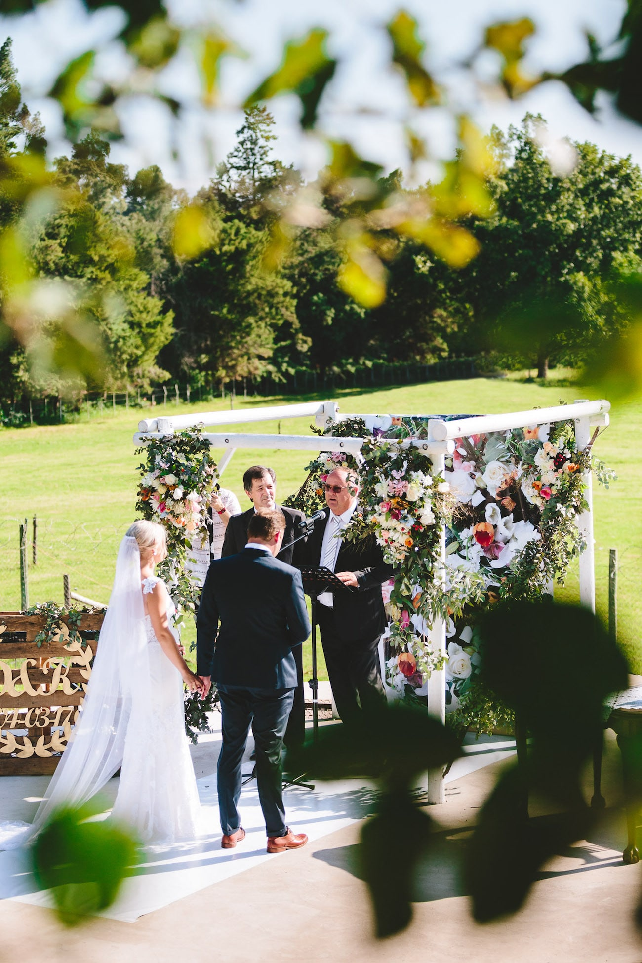 Floral Wedding Ceremony Arch | Credit: Charlie Ray Photography