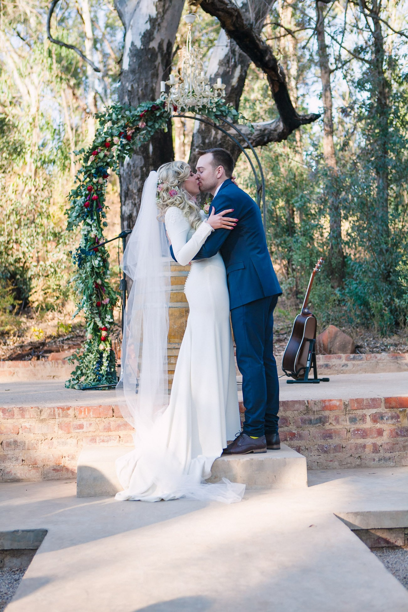 Forest Ceremony with Floral Arch | Joyous Jewel Tone Winter Wedding | Credit: Dust and Dreams Photography