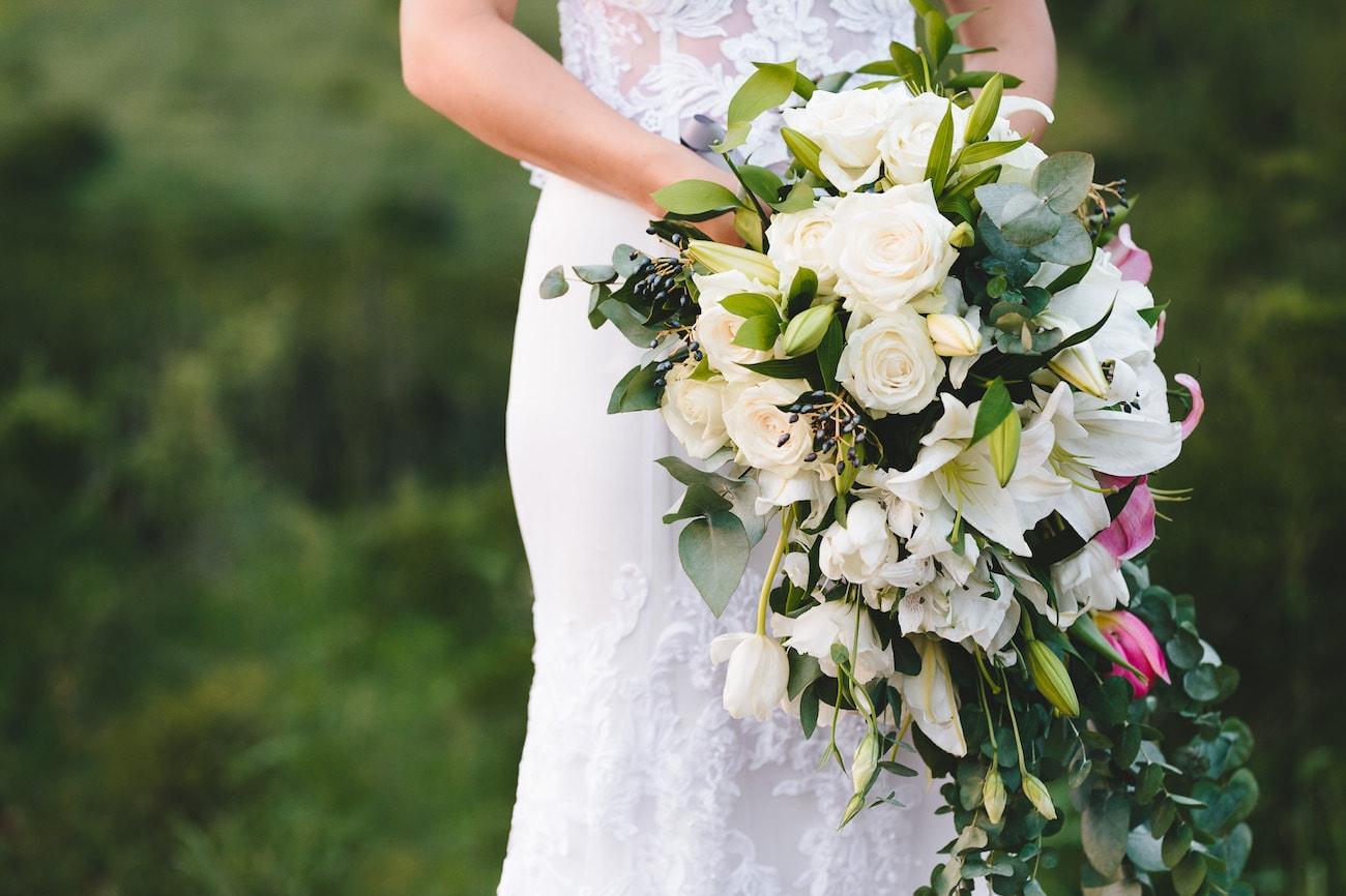 Cascade Bouquet with Roses, Lilies and Viburnum Berries | Credit: Charlie Ray Photography