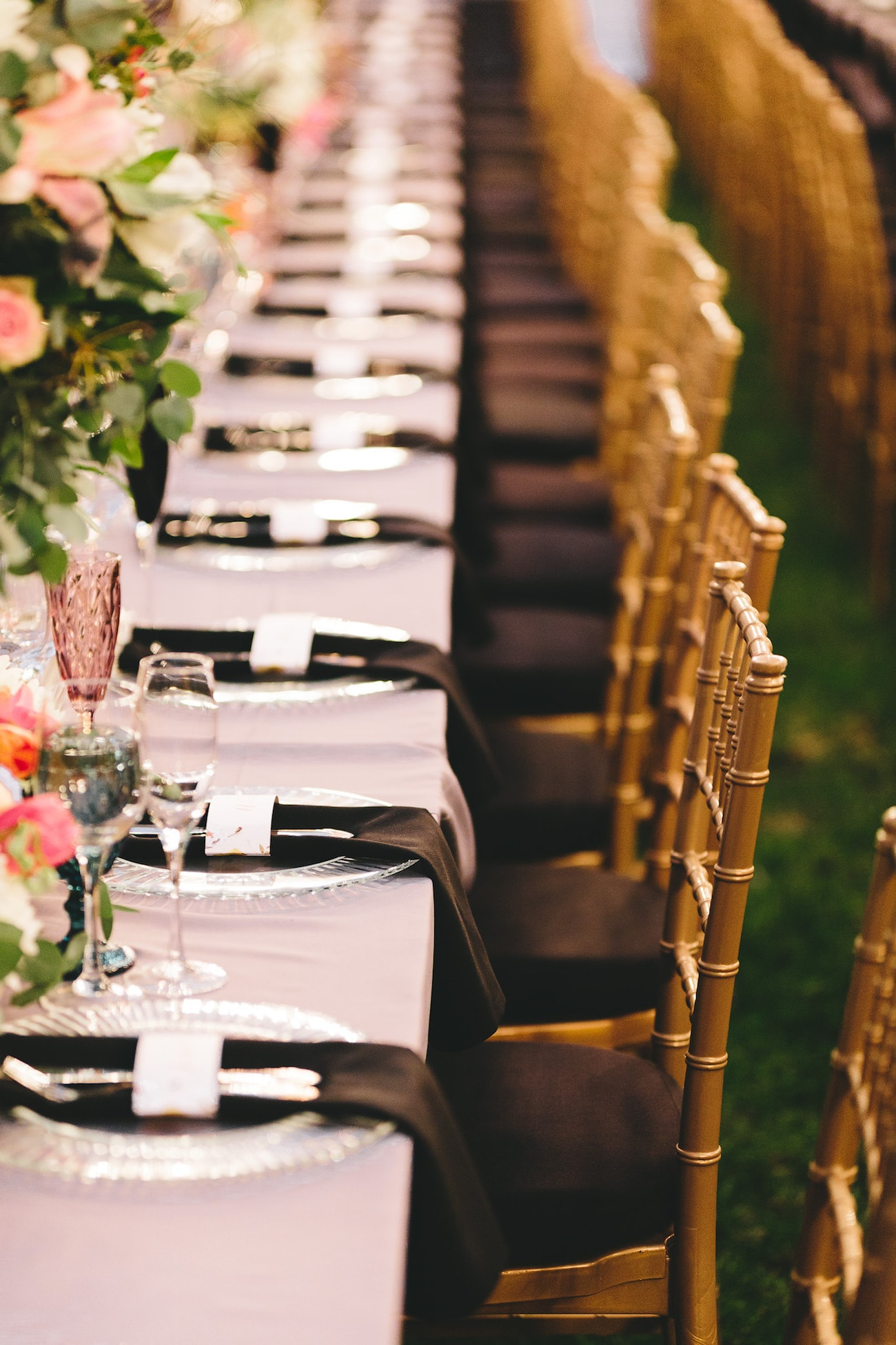 Table Decor with Black Napkins and Colorful Glassware   Credit: Charlie Ray Photography