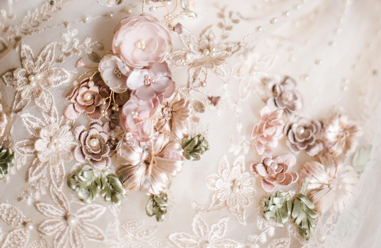 Ribbon Flower and Pearl Embellished Wedding Dress | Image: Roxanne Davison