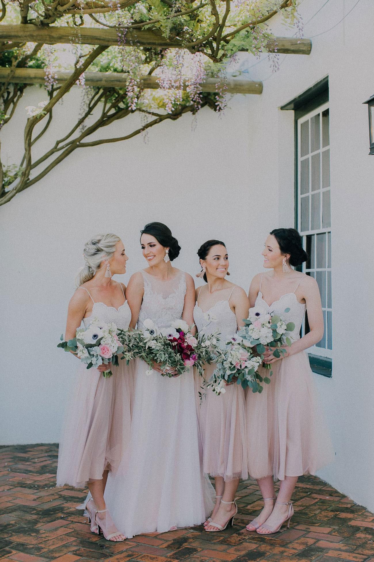 Bridesmaids in Blush Tulle Tea Length Dresses | Image: Michelle du Toit
