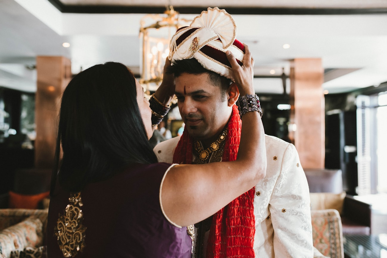Groom's Mother Putting On Safa | Image: Claire Thomson