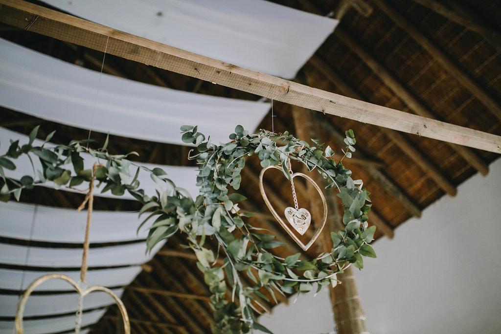 Greenery Wreath Ceremony Decor | Image: Jessica J Photography