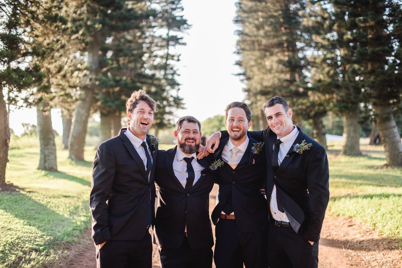 Groomsmen in Black Suits | Image: Roxanne Davison