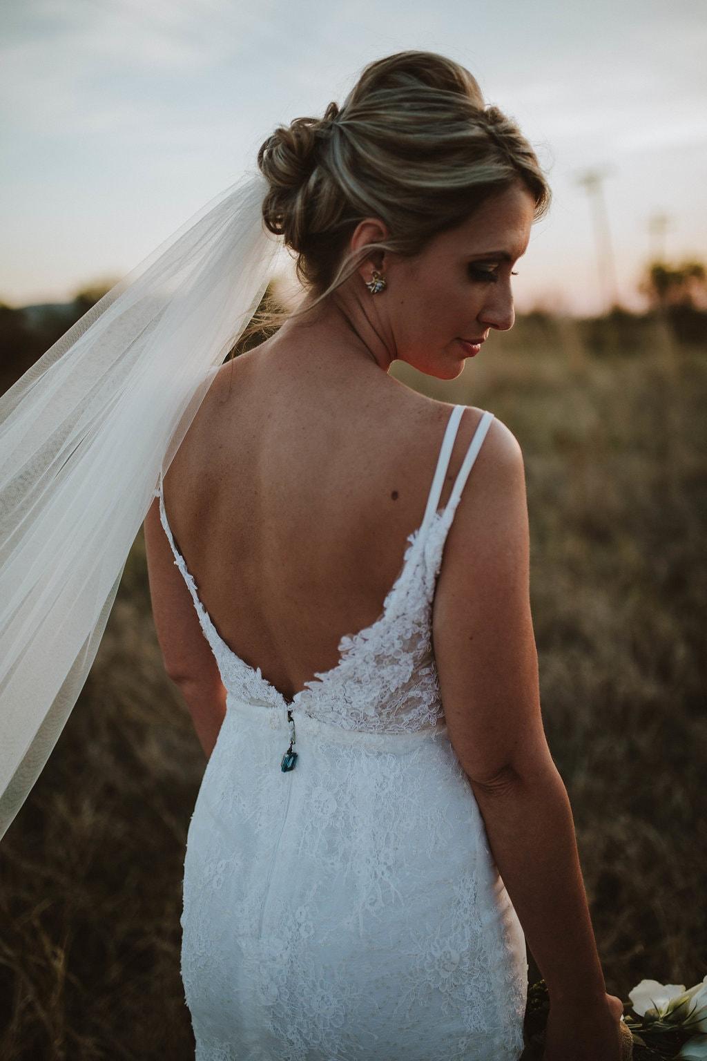 Kobus Dippenaar Low Back Wedding Dress with Heirloom Jewel | Image: Jessica J Photography