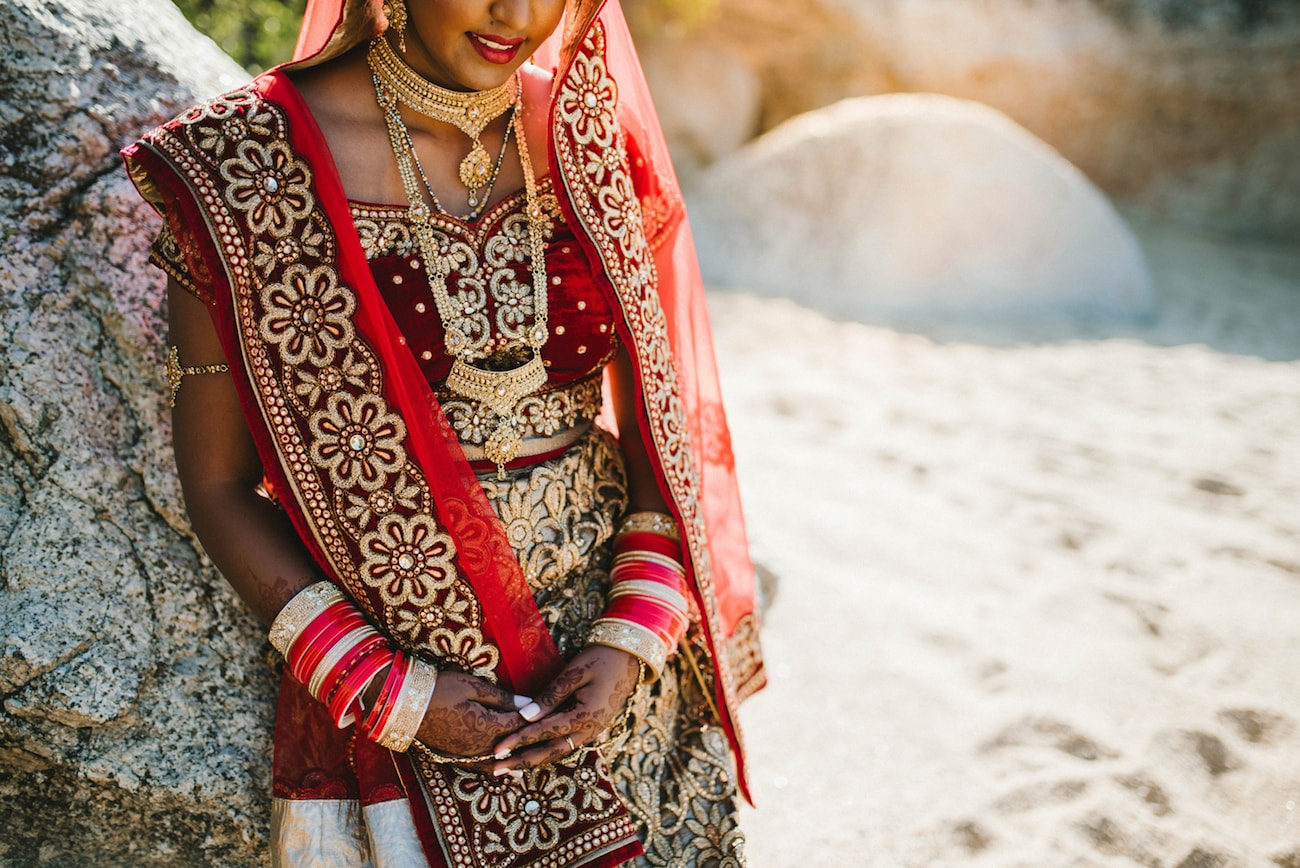 Scarlet Velvet & Gold Embroidery Bridal Lehnga | Image: Claire Thomson