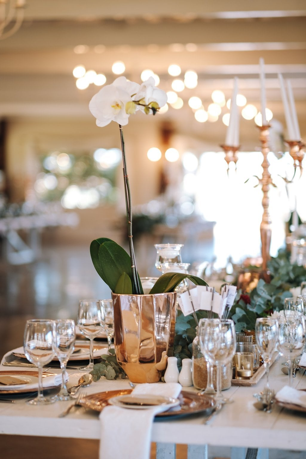 Orchid Centerpiece in Copper Vase | Image: The Shank Tank