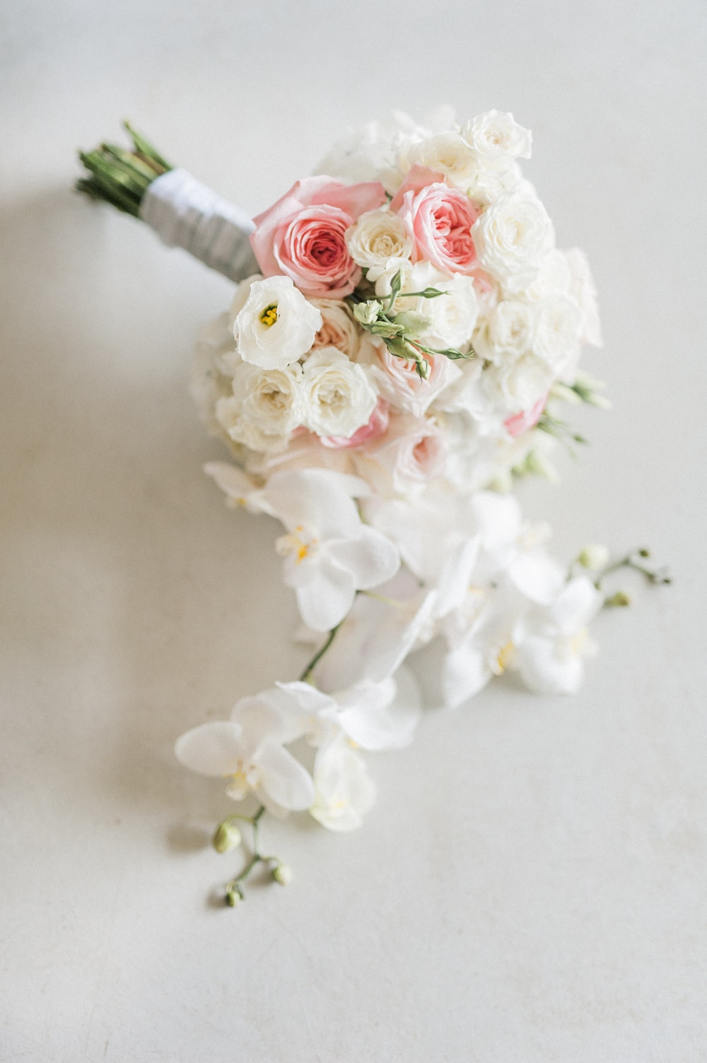 Blush & White Orchid & Rose Bouquet | Image: Bright Girl Photography