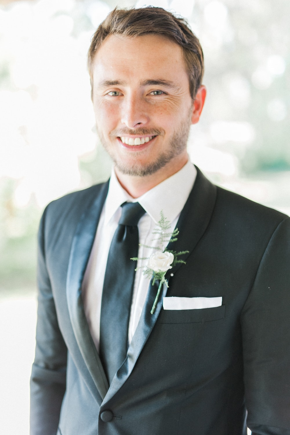Groom in Classic Black Suit & Tie | Image: Bright Girl Photography