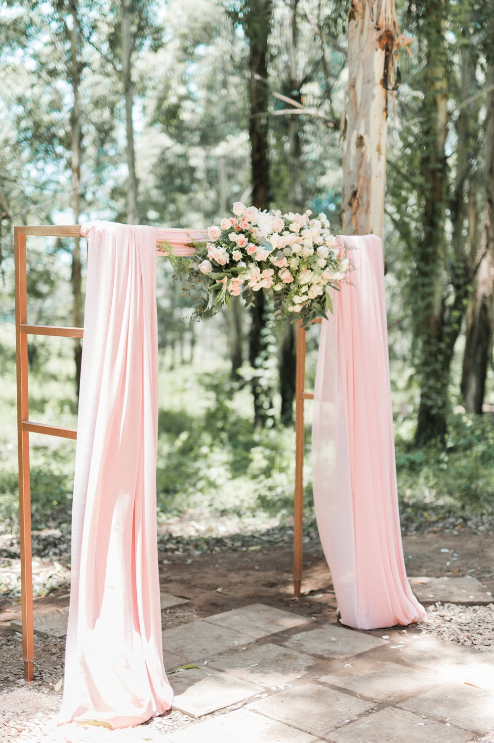 Draped Blush Floral Arch | Image: Bright Girl Photography