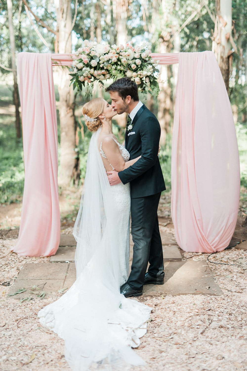 Blush Draped Floral Arch Wedding Ceremony | Image: Bright Girl Photography