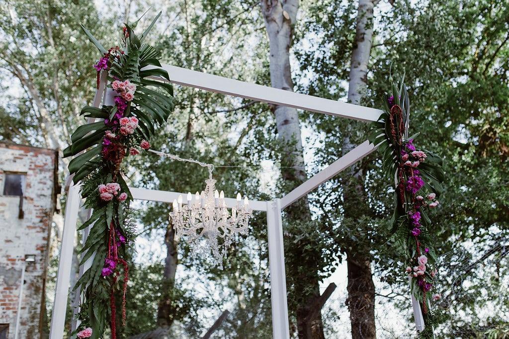 Modern Wedding Arch with Chandelier | Image: Jenni Elizabeth
