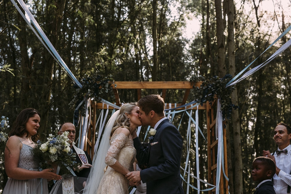 Forest Wedding Ceremony with Ribbon Arch | Image: Hayley Takes Photos