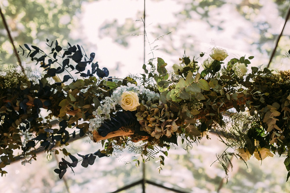Hanging Florals for Forest Wedding | Image: Hayley Takes Photos